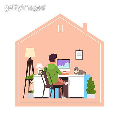 man freelancer using computer monitor working at home during coronavirus quarantine freelance
