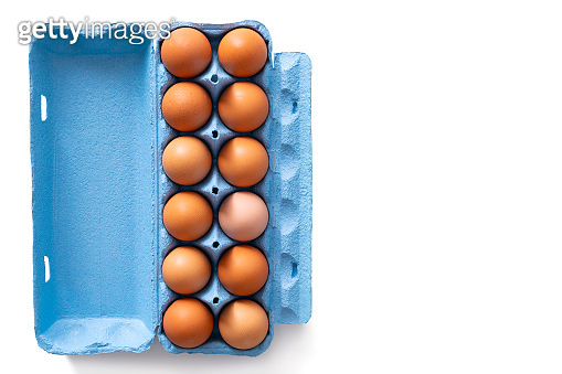 Dozen brown eggs carton blue isolated on white