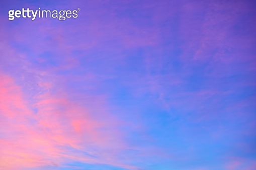 Colorful blue - orange sky with light clouds at sunset