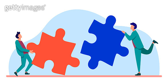 Two people connecting puzzle parts