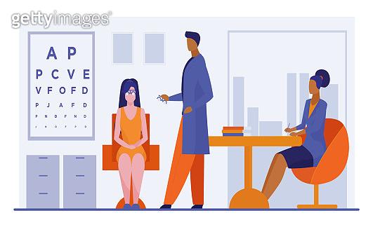 Ophthalmologist and nurse checking woman eyesight