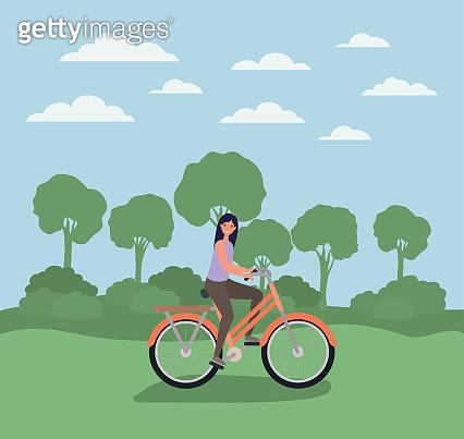woman cartoon riding bike at park vector design