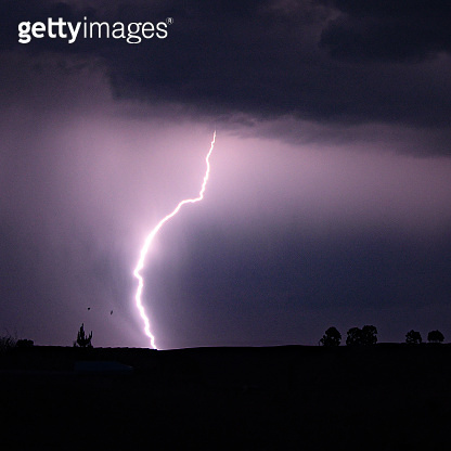 A lightning bolt during a storm in the Andes mountains, Ayacucho, Peru