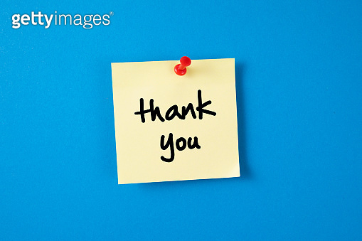 Yellow Adhesive Note Paper with Thank You Message on Blue background