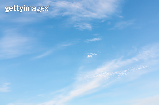 Light cirrus clouds in the blue sky on a sunny day, full frame image, background