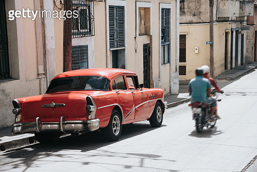 old red vintage car in the streets of Santiago de Cuba