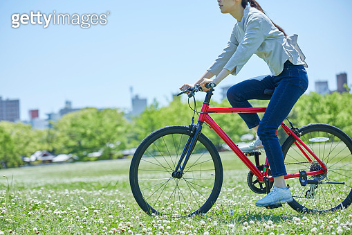 Young woman enjoying cycling on holidays