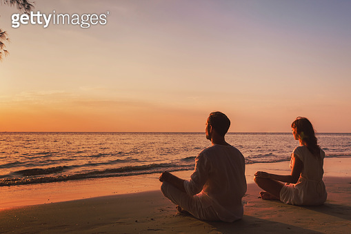 meditation and relaxation for couple, yoga group on the beach
