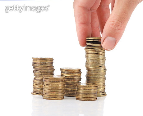 Savings. Investment concept with coins and a hand
