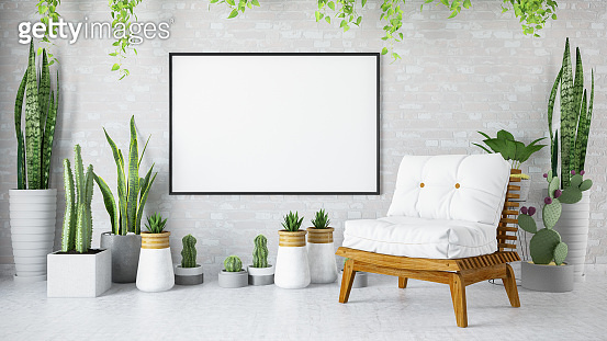 Empty Frame in Living Room with Green Plants and Armchair