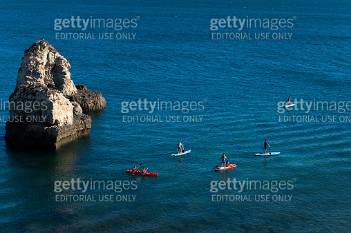 People kayaking and stand up paddle boarding at the Ponta Joao de Arens, near the Alemao Beach (Praia do Alemao) on a summer day