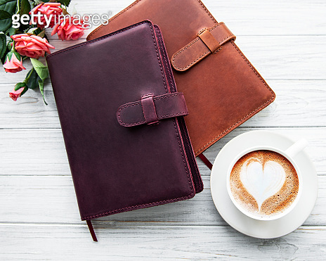 Leather notebooks and cup of coffee