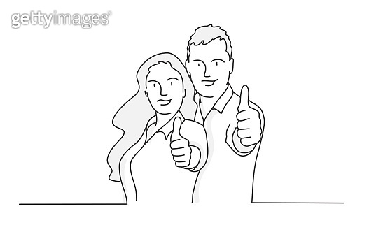 Couple making thumbs up