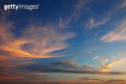 Sky and the clouds shined with sunset sun
