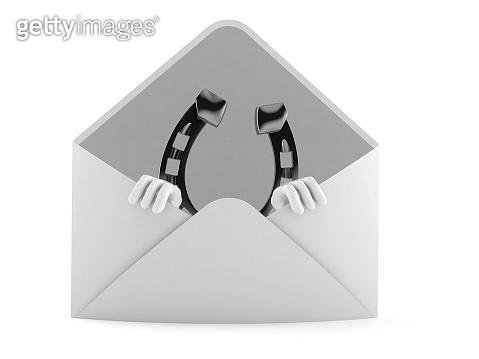Horseshoe character inside envelope
