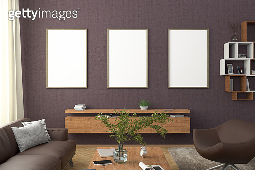 Vertical blank poster on wall in interior of modern living room