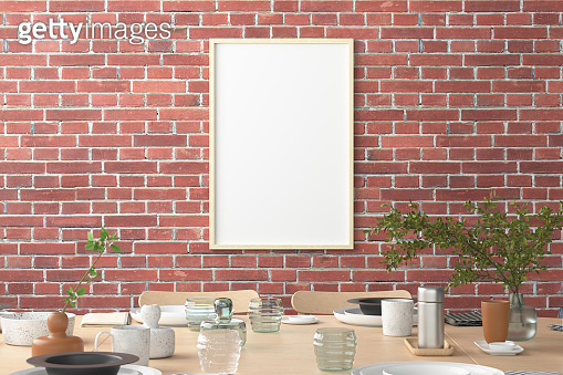 Vertical blank poster on wall in interior of modern dining room