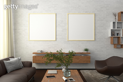 Square blank poster on wall in interior of modern living room