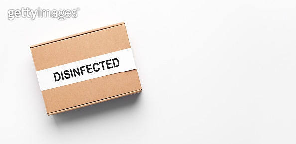 Delivery box disinfected from coronavirus on white