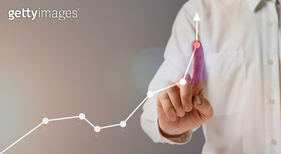 Business Growth Concept. Unrecognizable businessman pointing at financial graph with rising arrow