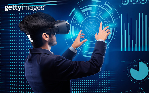 Businessman In Virtual Reality Headset Touching Digital Screen For Verification