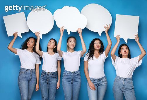 Diverse Girls Holding Empty Speech Bubbles Above Heads, Studio Shot