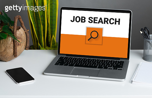 Laptop on the desk with job search engine on monitor