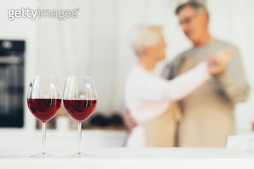 Unrecognizable Senior Couple Dancing Having Romantic Date At Home