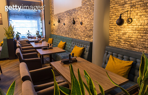 Cozy restaurant interior with sofas and tables for quick lunch