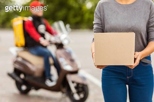Customer Woman Holding Delivered Parcel Box Standing Outside, Cropped