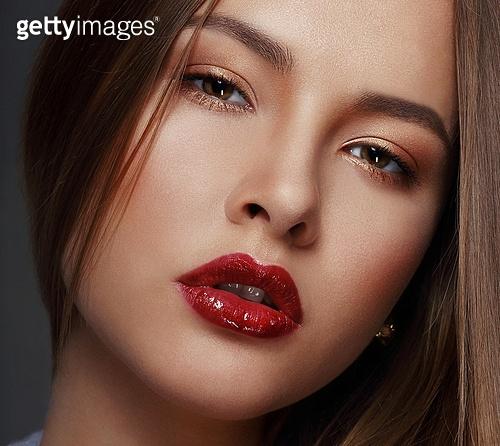 Studio Close Up Portrait of Young Sensual Beauty