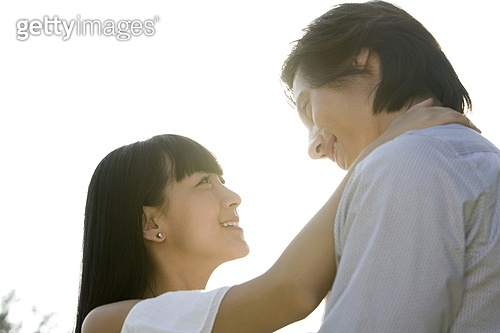 Young couple embracing each other in park