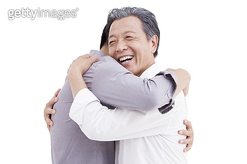 Father and son embracing