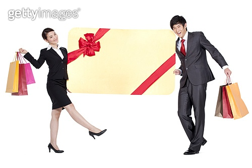 Colleagues Leaning Against an Oversized Wrapped Card