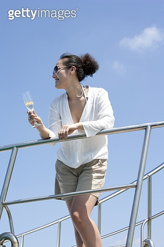 Carefree Young Woman Drinking Champagne