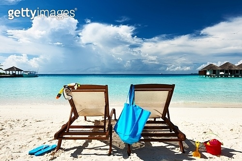 Tropical beach with chaise lounge at Maldives