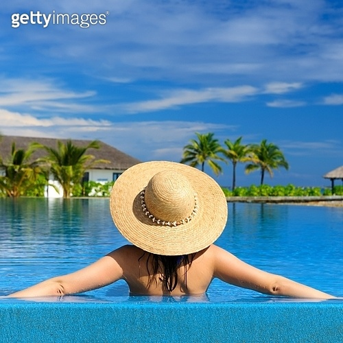 Woman in hat at the pool