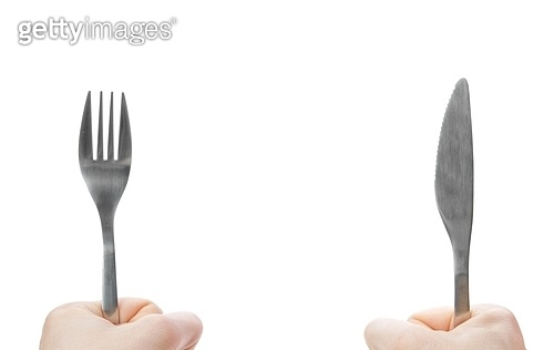 Idolated human hands with dinner equipments