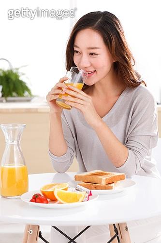Young woman eats breakfast