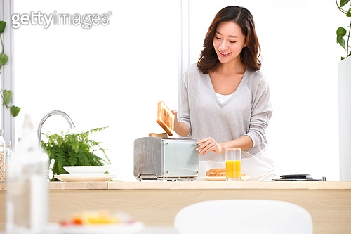 Young woman in the kitchen make breakfast