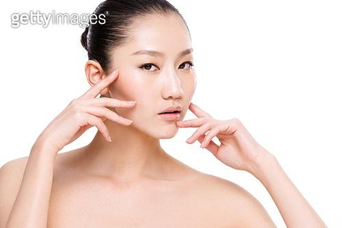 Young women wear makeup