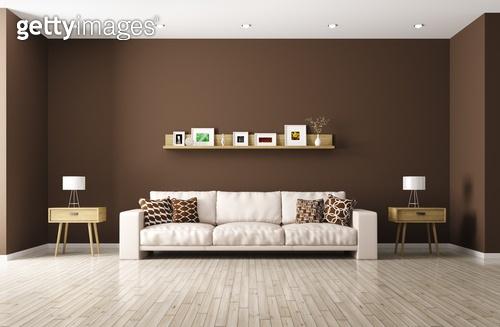 Modern interior of living room with beige sofa, shelf, side tables 3d rendering