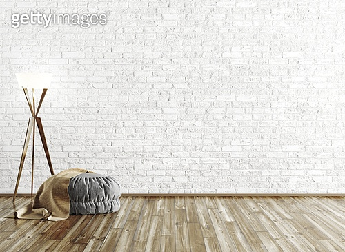 Gray ottoman covered with brown plaid and floor lamp over brick wall, room interior background 3d rendering