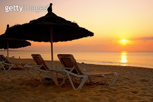 sunrise over the parasol on the beach in Tunisia