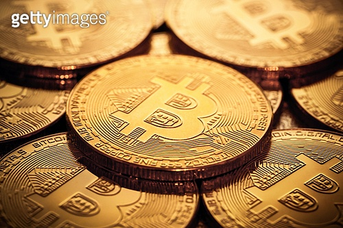 close up of bitcoins. close up of pile of bitcoins in backlight