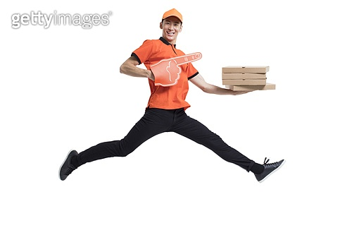 Cheerful pizza delivery person jumping