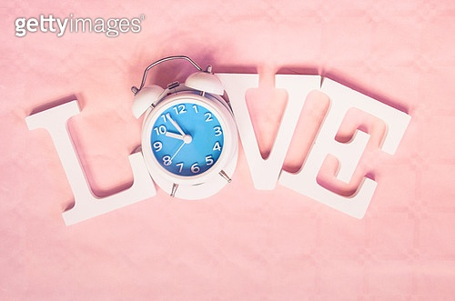 Love word with a clock as O