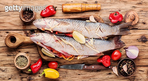 Fresh fish stuffed with vegetables.Cooking concept.Raw fish. Fresh uncooked fish