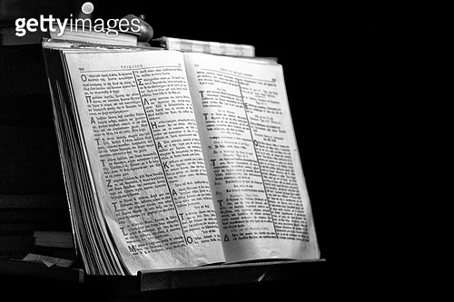in cyprus the old greek bible in the dark church like concept of faith and religion. in cyprus the old greek bible in the dark