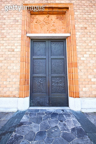 italy  lombardy     in  the vergiate  old   church  closed brick tower wall